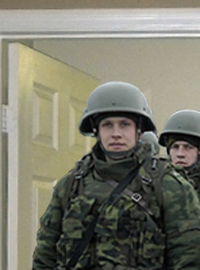 Russian soldiers wait outside Timmy Couch's bedroom door.