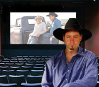 Donnie Ray Stevenson stands in front of the film that has threatened his sexuality.